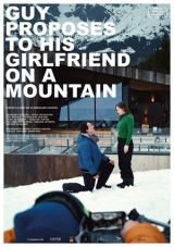 Guy proposes to his girlfriend on a mountain